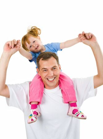 Portrait of father carrying her daughter on the shoulders photo