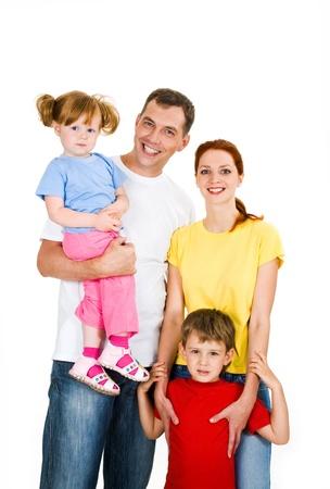 ni�o parado: Retrato de familia feliz aislado en un fondo blanco  Foto de archivo