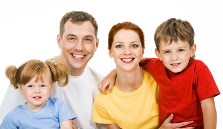Portrait of family looking at camera on a white background photo