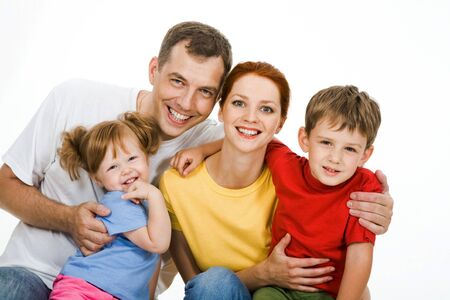 Portrait of father holding girl with boy embracing mother  Stock Photo - 8455183
