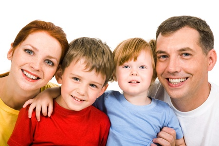 Portrait of cheerful parents with their two children on a white background Stock Photo - 8455345