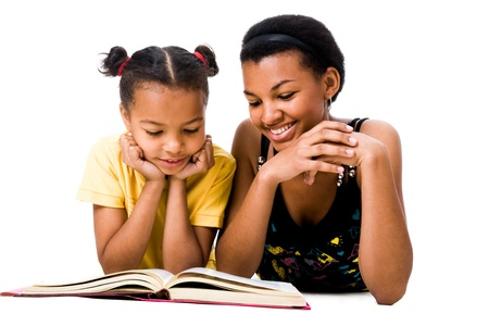 parenting: Image of woman and girl reading the book together Stock Photo