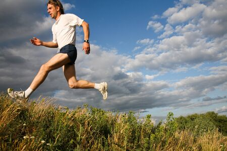 Horizontal image of sport man jumping outdoor  photo