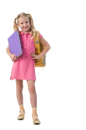Image of smart schoolgirl with big book in hand posing before camera Stock Photo - 8454966