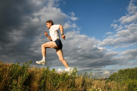 View of athlete jumping on the background of sky Stock Photo - 8455436