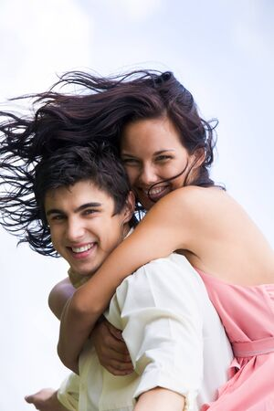 Photo of happy girl embracing handsome guy against blue sky at summer Stock Photo - 8455204