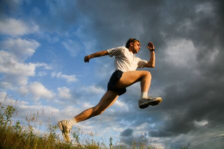 Image of pumped man training on open air  Stock Photo - 8455392