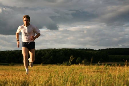 strong men: View of energetic man running in the forest