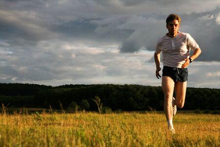 Photo of athlete in sportswear running outdoor  Stock Photo - 8455394