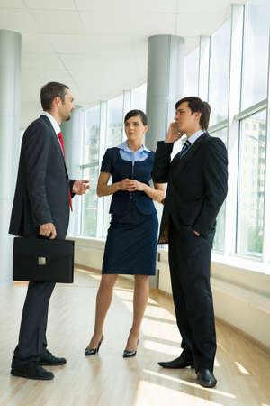 Confident business partners standing in office building and discussing work Stock Photo - 8455032