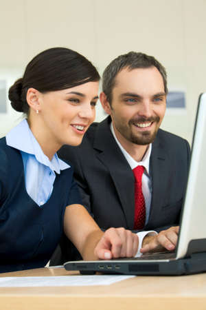 Portrait of happy partners looking at laptop monitor and discussing new project Stock Photo - 8455144