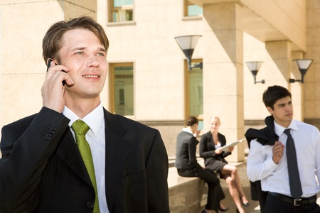 settles: Manager settles a corporate question through mobile phone