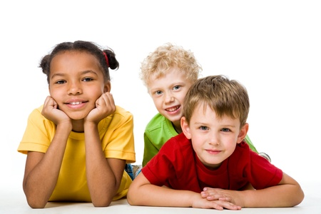 people isolated: Portrait of free children looking at camera and lying    Stock Photo