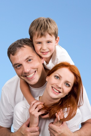 Portrait of smiling family on a blue background Stock Photo - 8475872