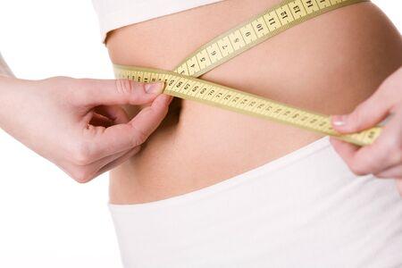 vientre femenino: Primer plano de vientre femenino con cinta alrededor de medici�n