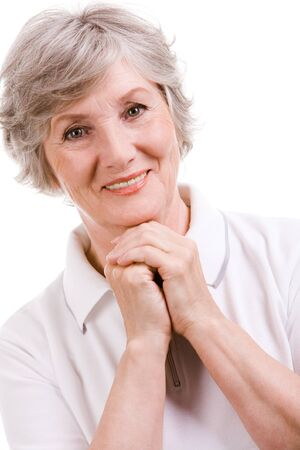 grannies: Portrait of mature woman smiling at camera over white background Stock Photo