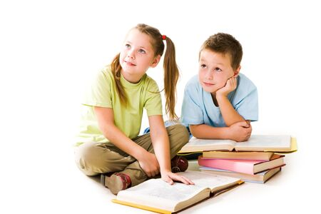 amused: Portrait of amused pupils looking aside during reading books Stock Photo