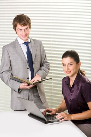 white collar workers: Portrait of smart white collar workers looking at camera with smiles Stock Photo