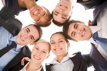 Below view of several successful partners looking at camera with smiles Stock Photo - 8492042