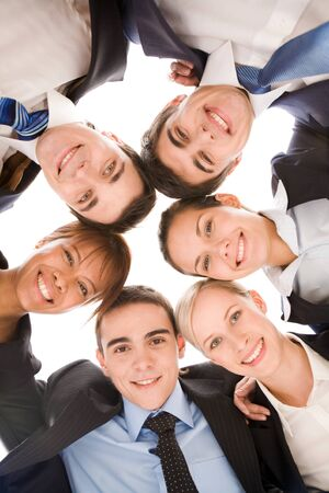 Below view of several smart colleagues looking at camera with smiles  Stock Photo - 8492032
