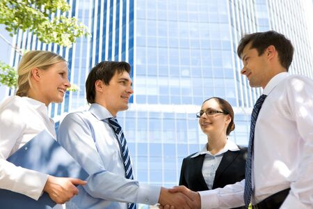 Photo of successful associates handshaking after striking deal outdoors at meeting Stock Photo - 8492000