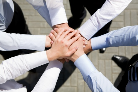 Above view of business partners hands on top of each other symbolizing companionship and unity Stock Photo - 8494271