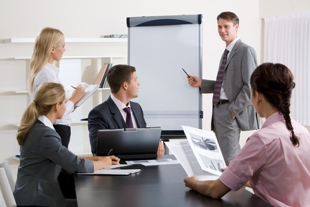 Image of confident businessman doing a presentation at business conference  photo