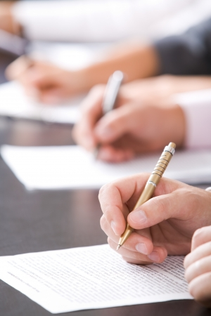 Close-up of human hands with pen over business document Stock Photo - 8494266