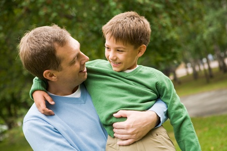 Image of happy man holding his son on hands outside Stock Photo - 8494194