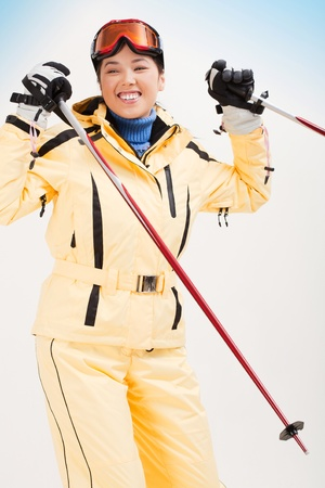 Portrait of sporty woman skiing photo