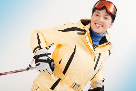 Portrait of happy sporty woman skiing photo