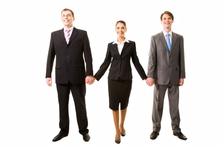 Team of three business people holding each other by hands Stock Photo - 8499653