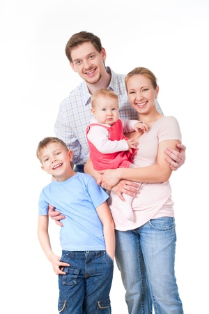 vertical: Portrait of happy family of four persons on a white background