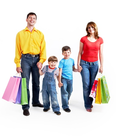 shopping spree: Portrait of family members holding each other by hands and looking at camera Stock Photo