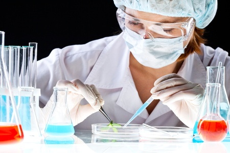 place of research: Close-up of clinician working with tools during scientific experiment in laboratory Stock Photo