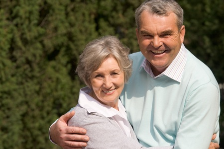Portrait of happy senior couple embracing each other and looking at camera on sunny day Stock Photo - 8501344