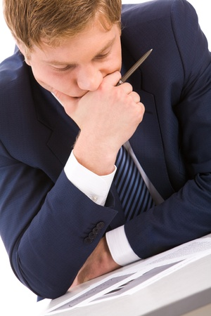 Portrait of thoughtful businessman looking at documents while planning work Stock Photo - 8507899