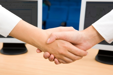 Photo of handshake of business partners after striking deal  photo