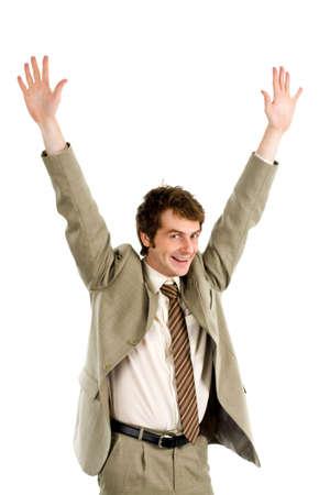 Portrait of joyful businessman with his arms raised photo