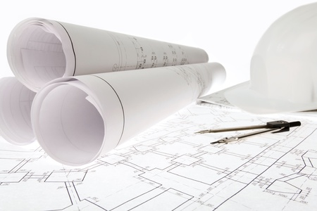 building blueprint: Close-up of blueprints with sketches of projects, helmet and dividers on them