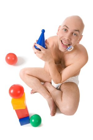 Above angle of baby man with pacifier in mouth playing with toys and smiling at camera photo