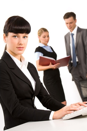 Portrait of smart secretary looking at camera on background of people working Stock Photo - 8506621