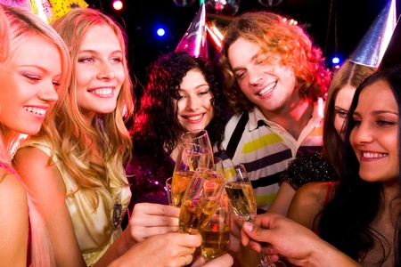 Portrait of boozing people in smart clothing toasting at birthday party Stock Photo - 8508326