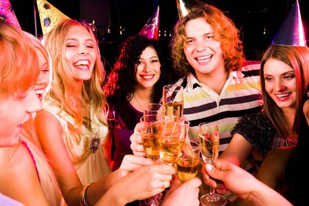 Portrait of joyful people with flutes of champagne toasting at birthday party Stock Photo - 8507030