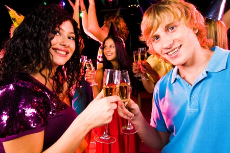 Portrait of happy couple with flutes of champagne toasting at birthday party Stock Photo - 8508296