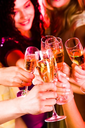 toasting wine: Image of friends hands holding crystal glasses full of champagne