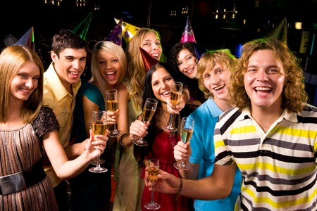 Portrait of glad people in smart clothing toasting at birthday party Stock Photo - 8508332