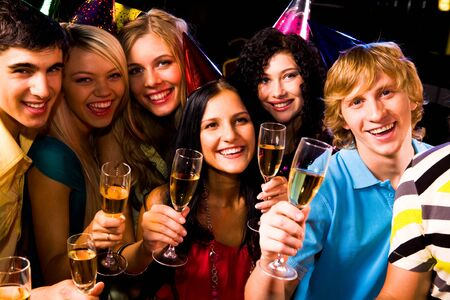 Portrait of happy friends with champagne at birthday party Stock Photo - 8507032