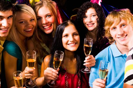 Portrait of happy friends with champagne looking at camera at birthday party Stock Photo - 8508312