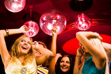 night club: Pretty girls moving at disco while spending time in night club